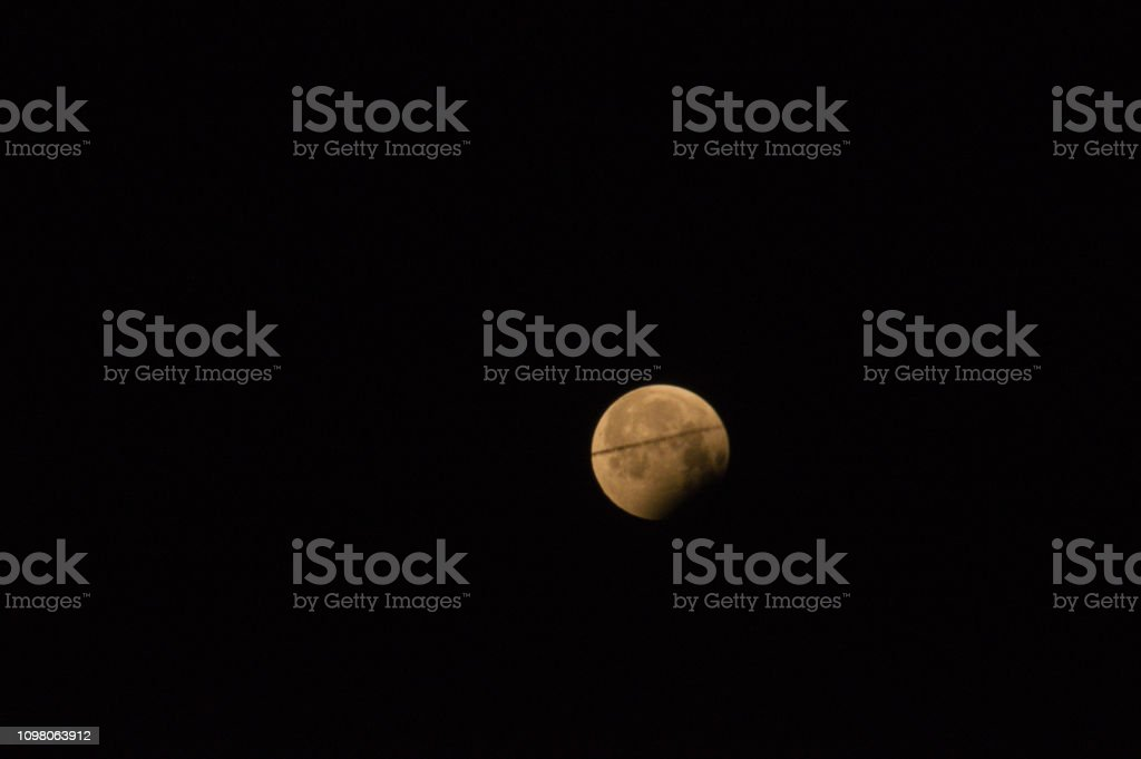 Unique Super Blood Moon with crossing airpolane and photographic...