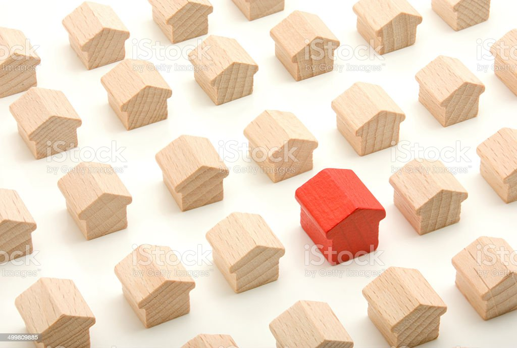 Unique wooden house in group stock photo