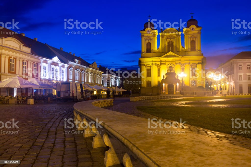 Unirii Square with Roman Catholic Dome at dusk stock photo