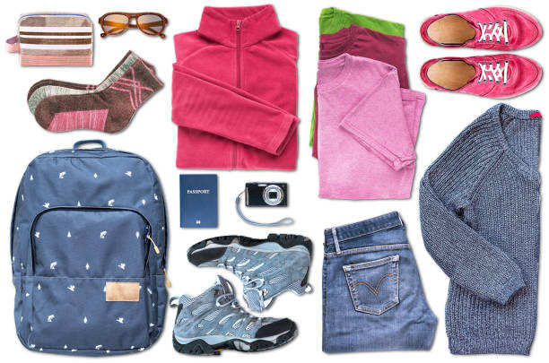 Unisex travel essentials including a passport filling the space on white background stock photo