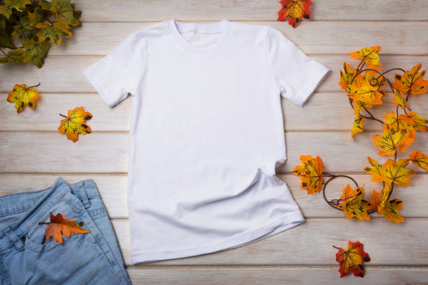 Unisex T-shirt mockup with fall leaves stock photo