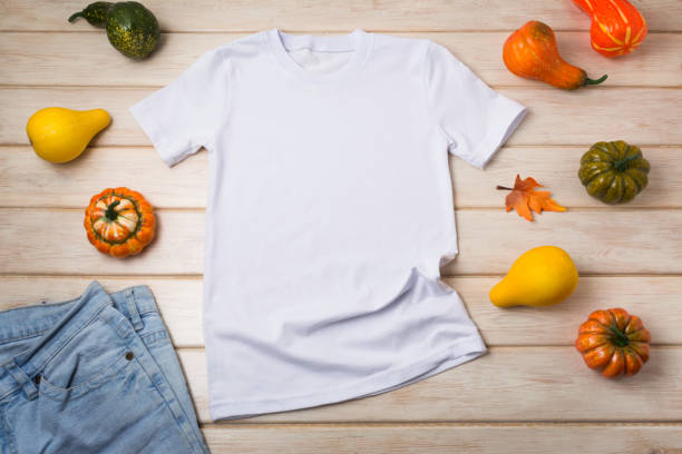 Unisex T-shirt mockup with pumpkins stock photo