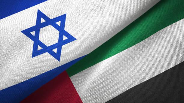 verenigde arabische emiraten en israël twee vlaggen samen textiel doek stof textuur - israël stockfoto's en -beelden