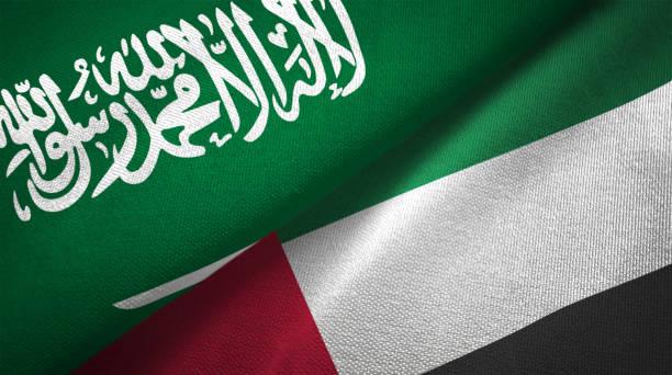 united arab emirates and saudi arabia two flags together realations textile cloth fabric texture - uae flag zdjęcia i obrazy z banku zdjęć
