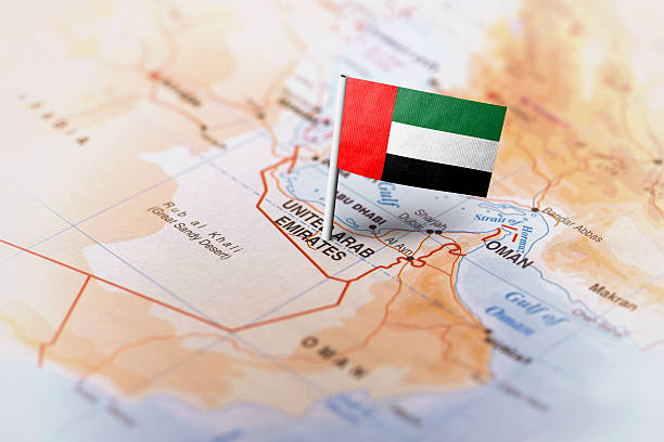 united arab emirates pinned on the map with flag - uae flag 뉴스 사진 이미지