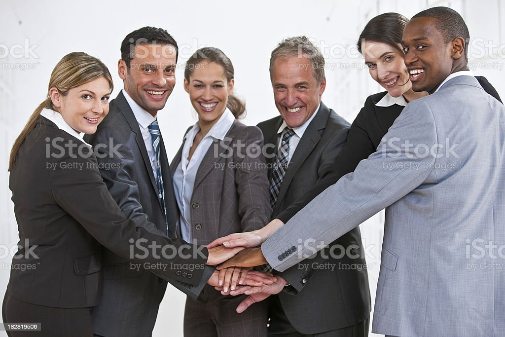 United Business Group joining hands royalty-free stock photo