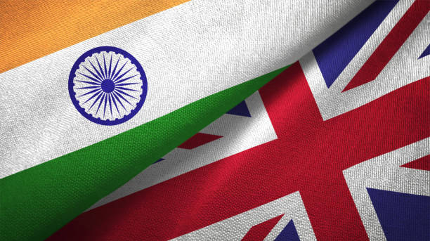 United Kingdom and India two flags together textile cloth fabric texture stock photo