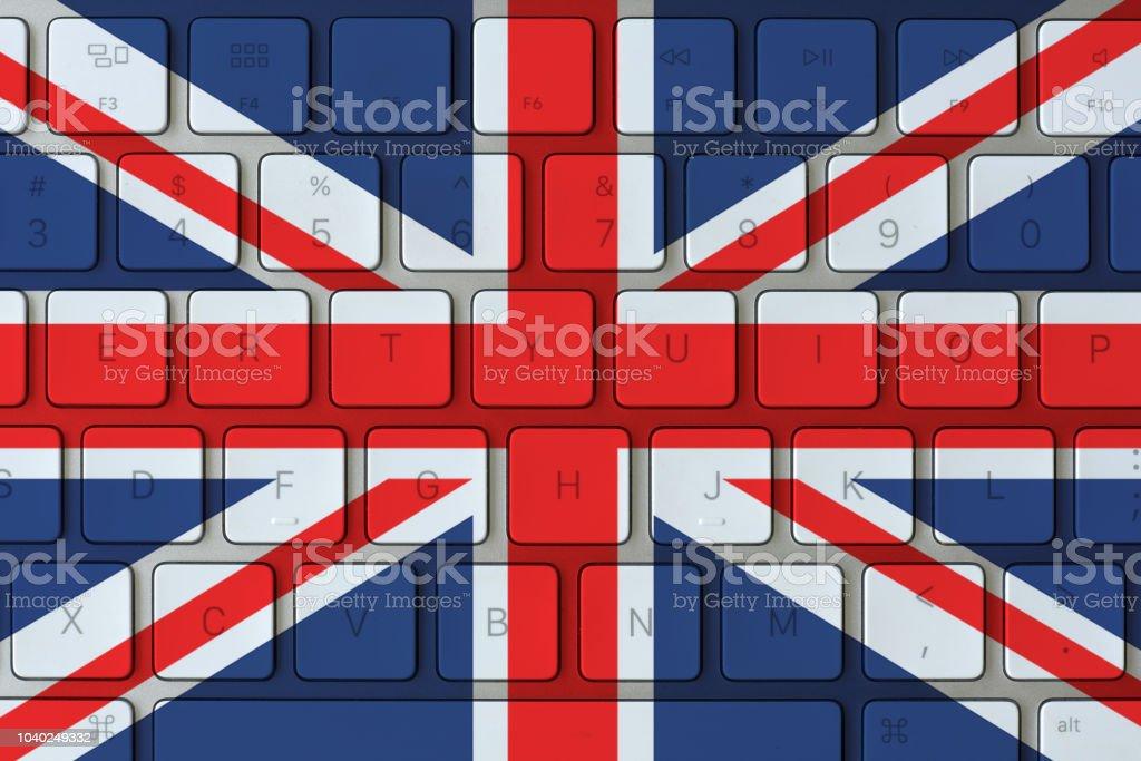 United Kingdom flag and computer keyboard in the background. UK flag