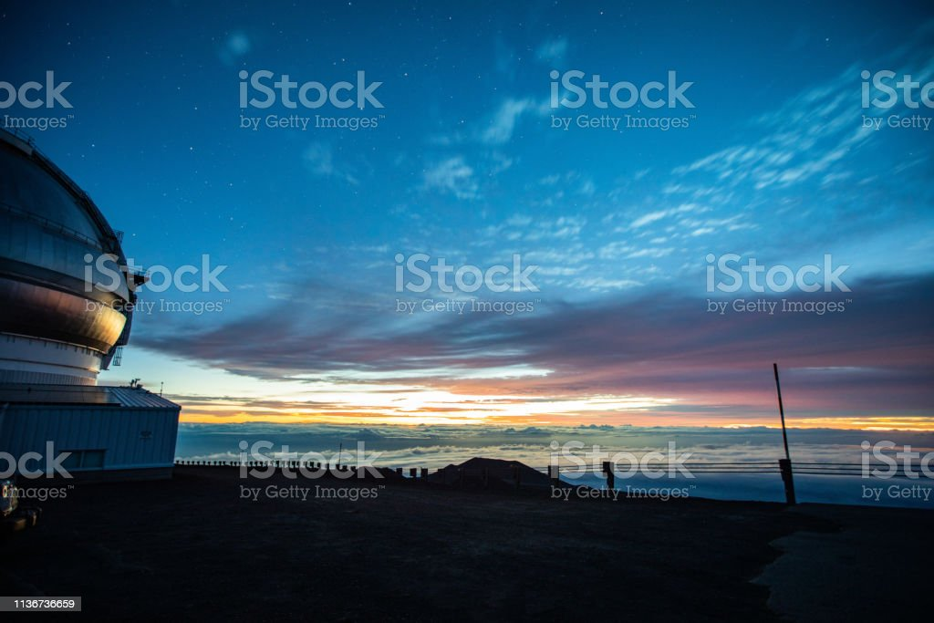 United Kingdom Infrared Telescope(UKIRT) and Sunrise view on Mauna Kea - Big Island, Hawaii, USA stock photo
