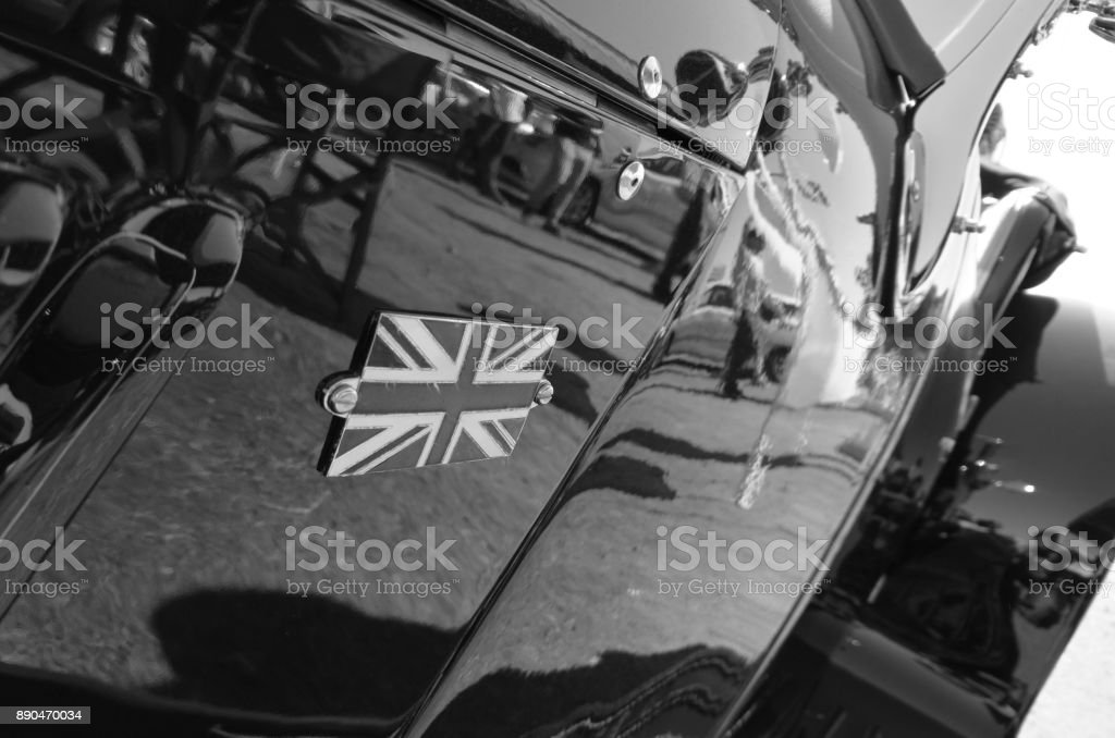 United Kingdom National Union Jack logo on classical car in black and white stock photo