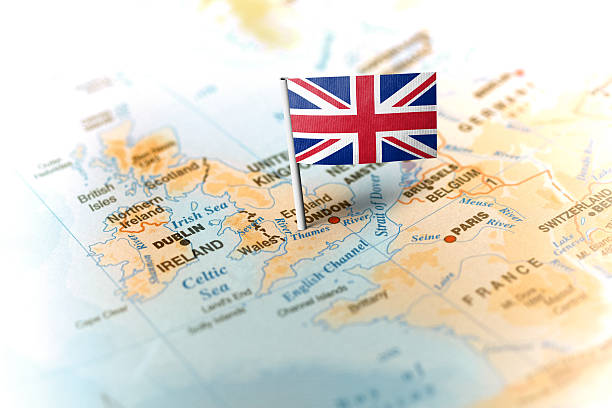 United Kingdom pinned on the map with flag The flag of United Kingdompinned on the map. Horizontal orientation. Macro photography. uk map stock pictures, royalty-free photos & images