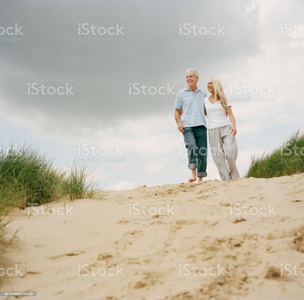 United Kingdom, Rye, Camber Sands, couple walking on sand dunes royalty-free stock photo