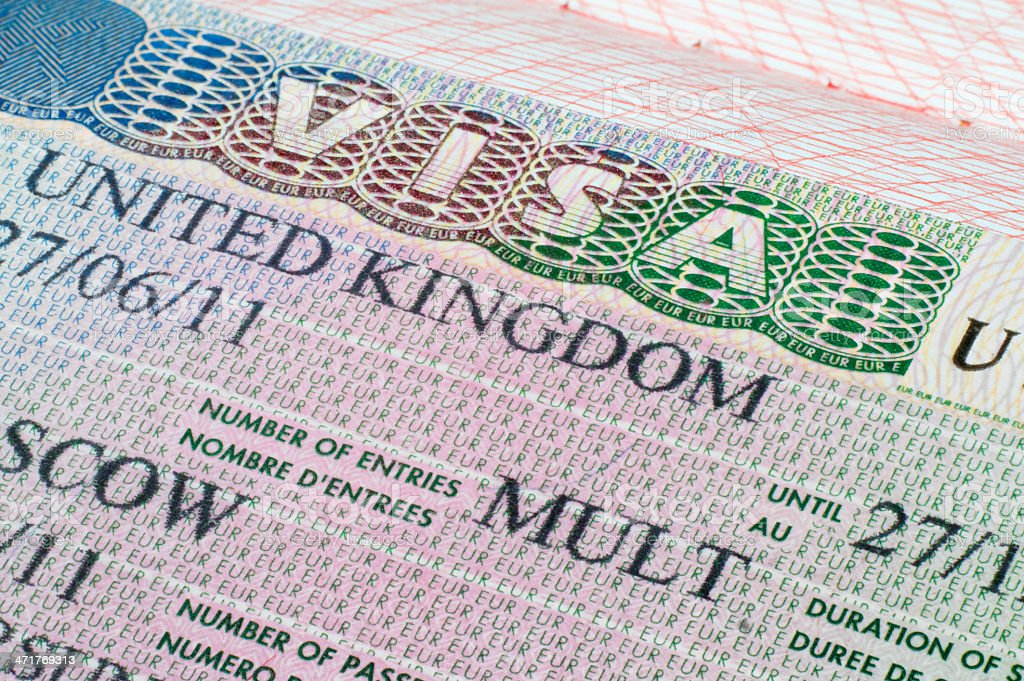 United Kingdom visa in passport stock photo