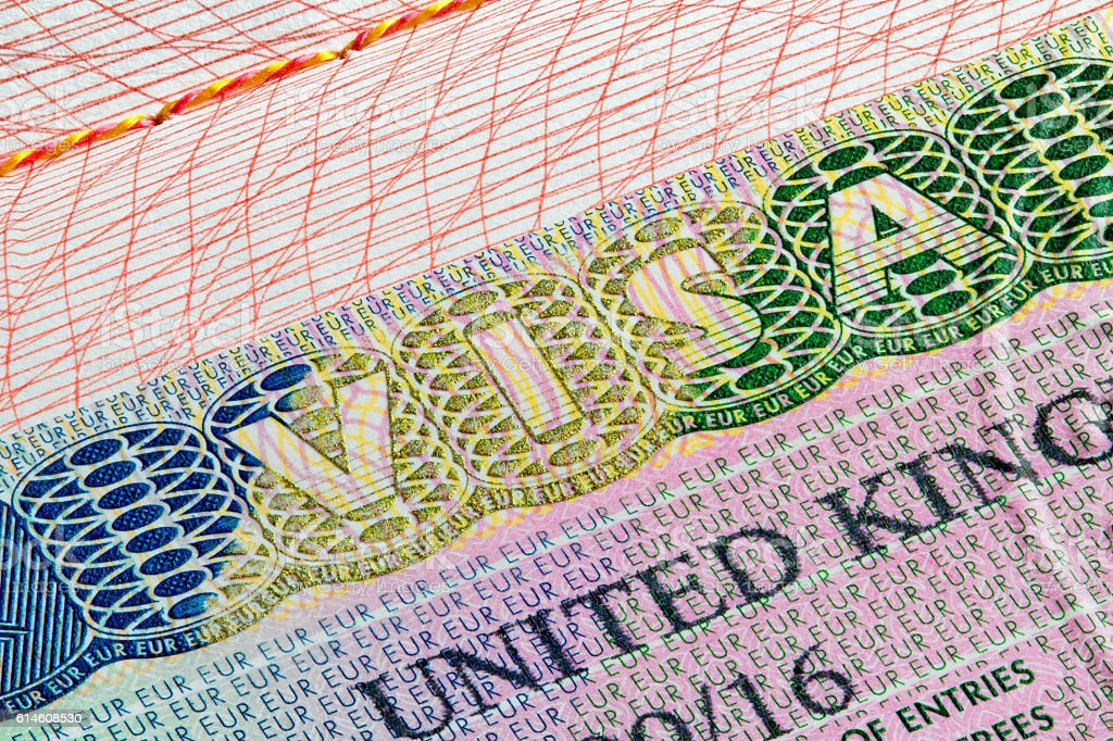 United Kingdom visa stamp in passport stock photo