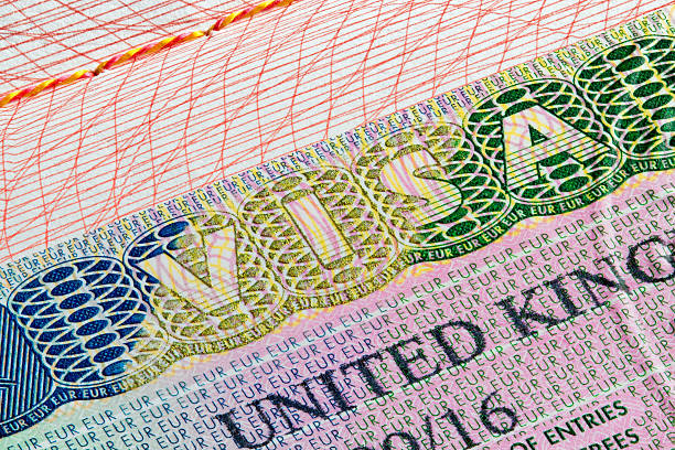 United Kingdom visa stamp in passport United Kingdom visa stamp on passport page passport stamp stock pictures, royalty-free photos & images
