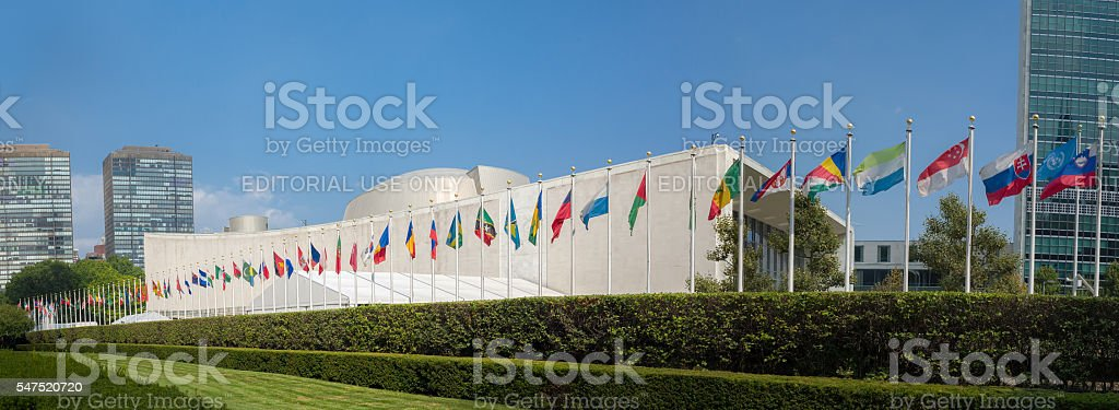 UN United Nations general assembly building with world flags stock photo