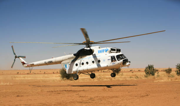 United Nation's World Food Program (WFP) helicopter landing at Kutum airstrip, northwest of Al Fashir, the capital of North Darfur, Sudan. Kutum, Sudan - 14 Feb 2010: United Nation's World Food Program (WFP) Russian-made MI-8 helicopter landing at Kutum airstrip, northwest of Al Fashir, the capital of North Darfur. omdurman stock pictures, royalty-free photos & images