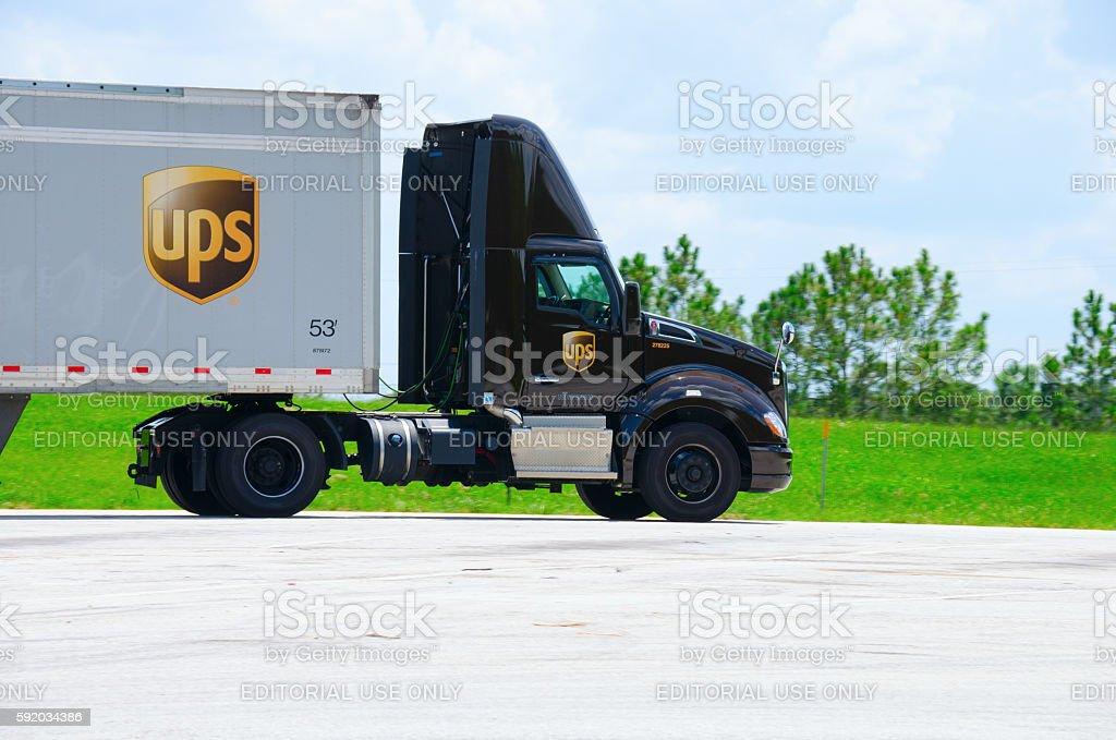 United Parcel Service UPS cargo semi truck on road stock photo