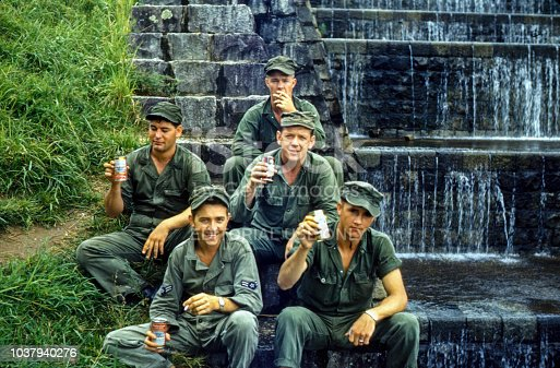 Five US Air Force Soldiers pose near a man made fountain in China South Korea.  The soldiers were on leave from the war and were staying at the Naval base.