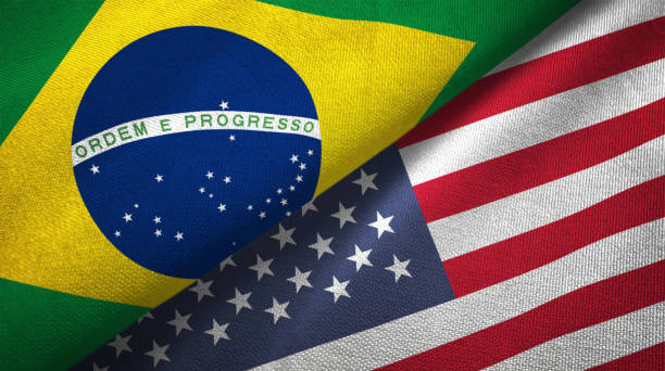 United States and Brazil two flags together realations textile cloth fabric texture stock photo