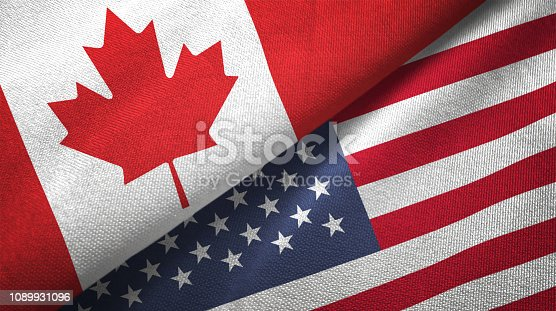 istock United States and Canada two flags together realations textile cloth fabric texture 1089931096