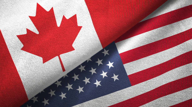United States and Canada two flags together realations textile cloth fabric texture United States and Canada flag together realtions textile cloth fabric texture canada stock pictures, royalty-free photos & images