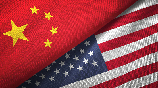 istock United States and China two flags together realations textile cloth fabric texture 1089916444