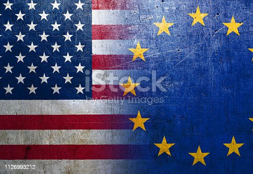 istock United States and European Union flags on the grunge metal background 1126993212