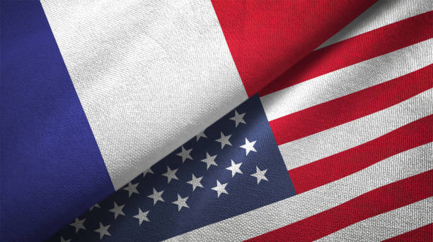 United States and France two flags together realations textile cloth fabric texture stock photo