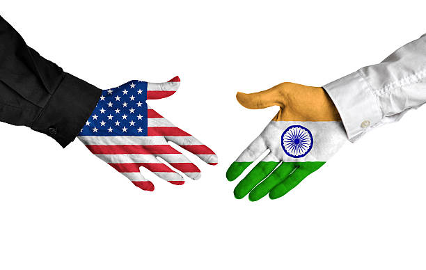 United States and India leaders shaking hands on a deal stock photo