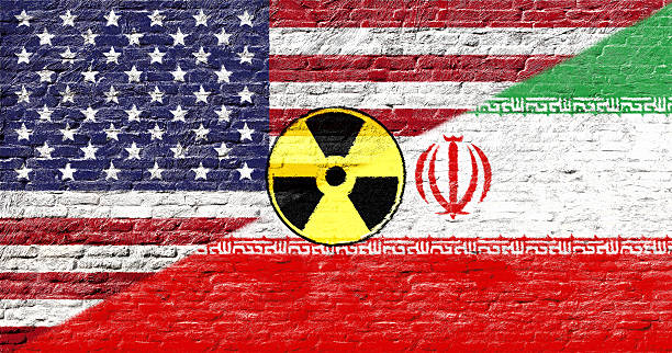 united states and iran - national flags on brick wall - nuclear weapon stock photos and pictures