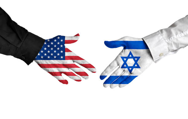 United States and Israel leaders shaking hands on a deal agreement Hands of two important leaders with national flags for the countries of the United States and Israel extended toward each other for a handshake, isolated on a white background. foreign affairs stock pictures, royalty-free photos & images