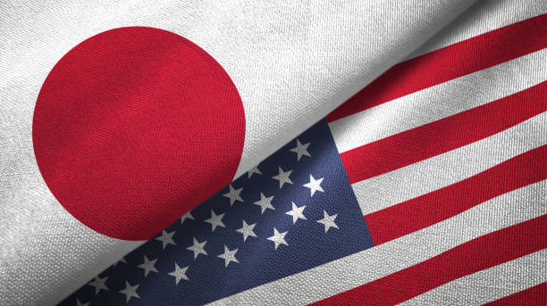 United States and Japan two flags together realations textile cloth fabric texture stock photo