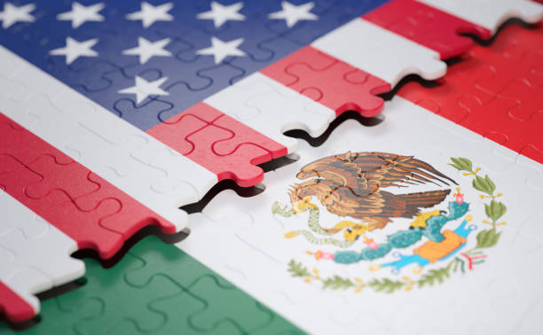 United States And Mexico Flag Puzzle Flag of the United States Of America and Mexico in the form of puzzle pieces. diplomacy stock pictures, royalty-free photos & images