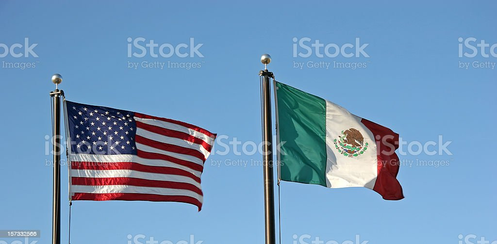 United States And Mexico Flags stock photo