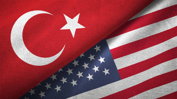 United States and Turkey two flags together textile cloth fabric texture stock photo
