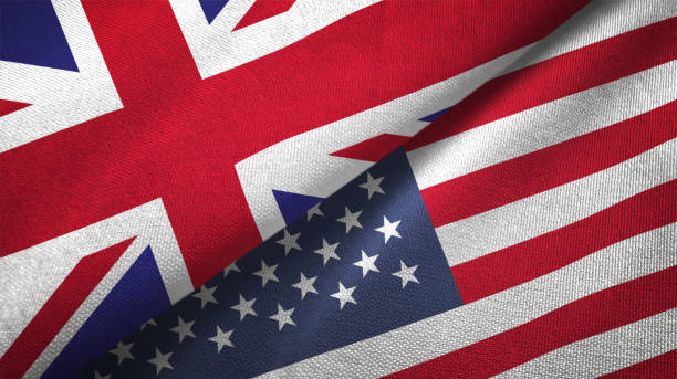 United States and United Kingdom two flags together realations textile cloth fabric texture stock photo