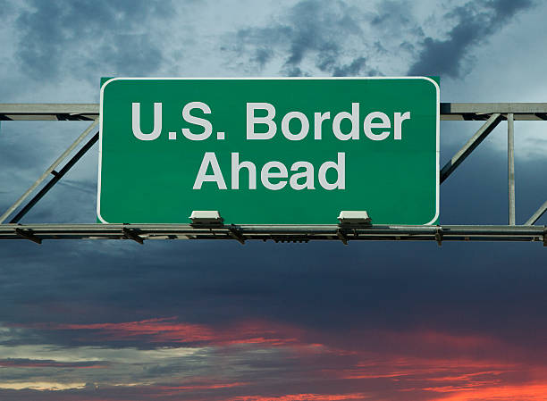 """United States Border Ahead A sign that says """"United States Border Ahead."""" border patrol stock pictures, royalty-free photos & images"""