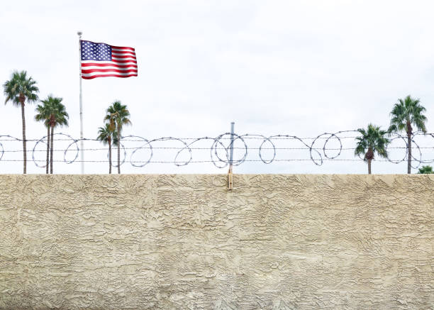 United States Border Wall Wall with secure barbed wire fence along the southern border of the United States international border barrier stock pictures, royalty-free photos & images