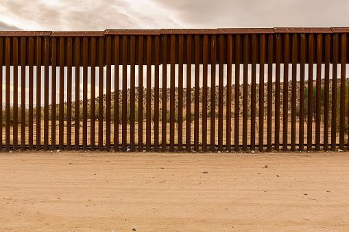View of Mexico through international border wall at Jacumba California