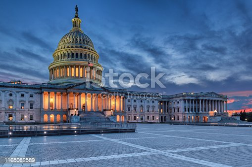 The United States Capitol building at sunset, Washington DC, USA.