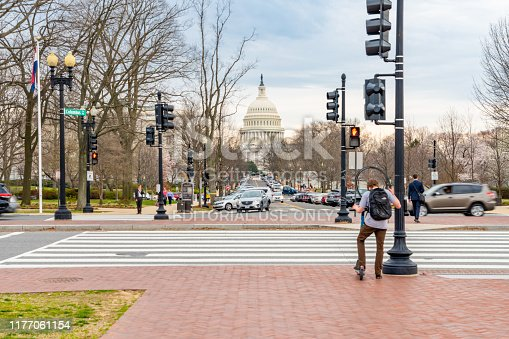 US Capitol Building in the distance, tourists are walking on Columbus Circle of Union Station in Washington DC, USA.