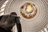 Close up view of the intricate detail of the U.S. Capitol Rotunda ceiling and silhouette of George Washington.