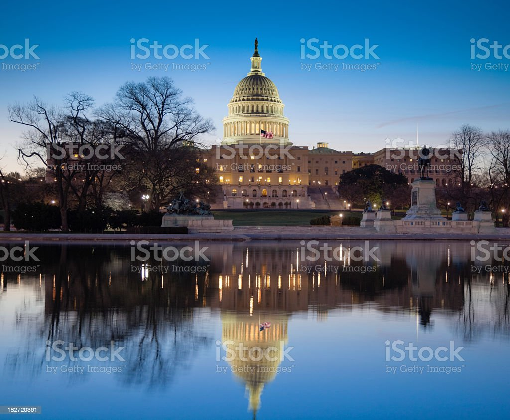 United States Capitol taken at night from across the water stock photo