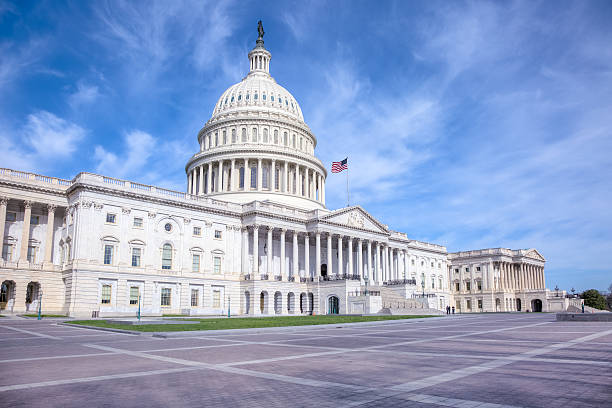 United States Capitol under Blue Sky with Fluffy White Clouds stock photo