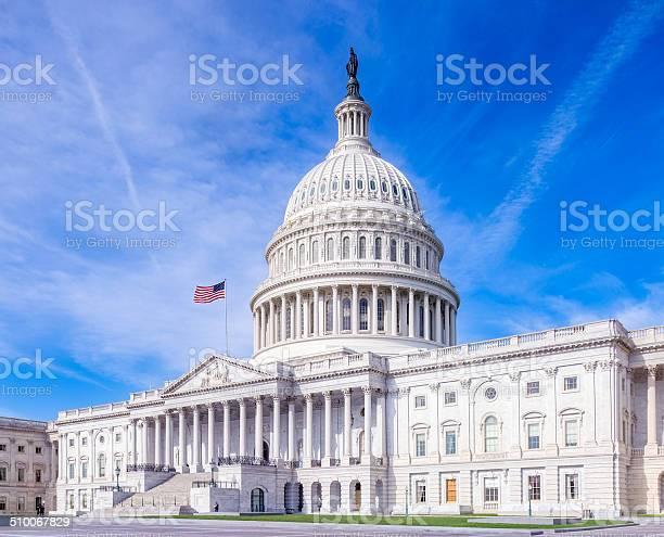 United states capitol with american flag under brilliant sky picture id510067829?b=1&k=6&m=510067829&s=612x612&h=4lybdh8ewpstfmsp hvvnq9cfncgv6k18jnvezfbsja=