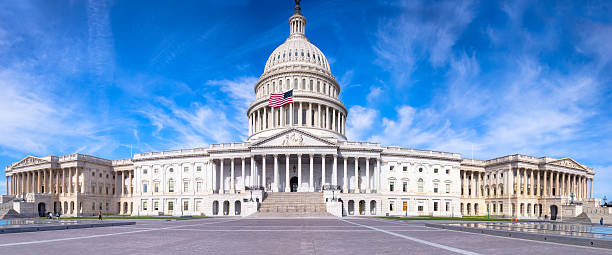 United states capitol with flag flying under blue sky picture id501573391?b=1&k=6&m=501573391&s=612x612&w=0&h=mdmgis50iuotkzeqimvjh9red8yy2ulrf2brfvjpvf0=