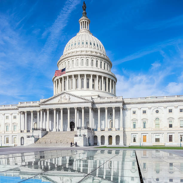 United States Capitol with Reflection in Visitor Center Skylights stock photo