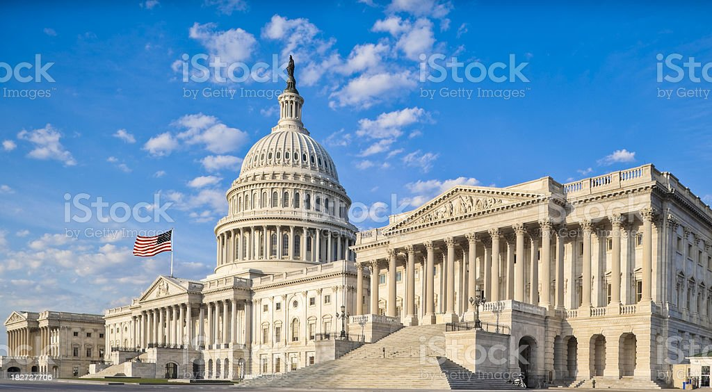 United States Capitol with Senate Chamber Under Blue Sky stock photo
