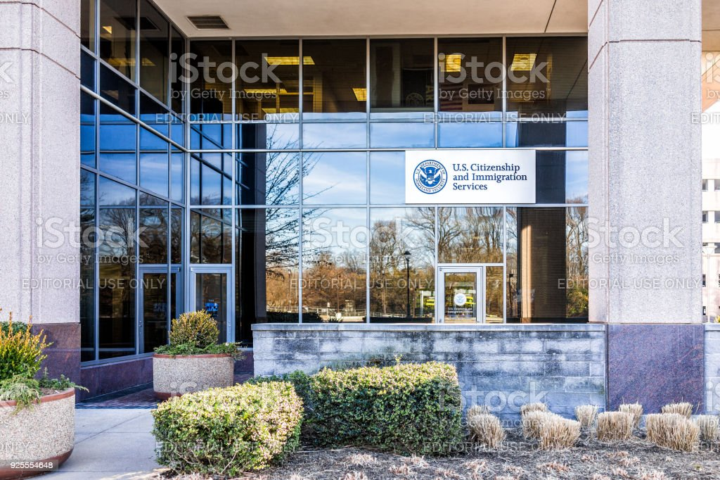 USCIS US United States Citizenship and Immigration Services field main office entrance in Virginia with sign stock photo